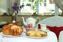 Tea time with sweet bread and muffin, apple tart and fruit. In the glass house Stock Images
