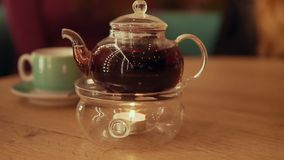 Tea time. Teapot with tea at table.  stock video