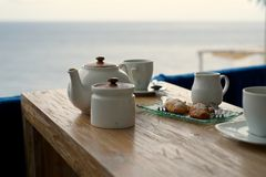 Tea time. On a terrace with sea view Royalty Free Stock Photo