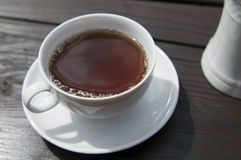 Tea time. A white cup of bleack tea stock images