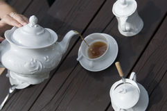 Tea time. Wooden table in tea time royalty free stock photo
