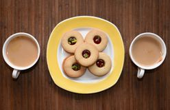 Tea time and yummy biscuits on the side Stock Photography