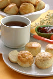 Tea tine I. Tea table with scones (cookies), tea cup, on a yellow napkin Royalty Free Stock Image