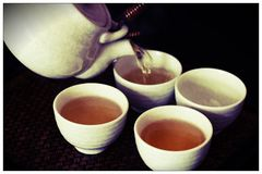 Tea to tantalise any guests. Chinese tea, this is best served hot and in small cups to keep the tea at the right temperature. Jasmine tea is served in most asian Royalty Free Stock Photography