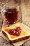Tea and toast bread with jam in shape of hearts Royalty Free Stock Photo