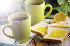Tea and toast with honey Stock Images