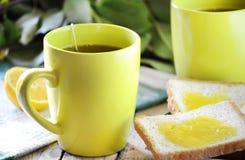 Tea and toast with honey Stock Photos
