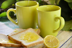 Tea and toast with honey Royalty Free Stock Images