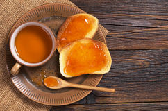 Tea and toast with jam Royalty Free Stock Photography