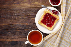 Tea and toast with jam Royalty Free Stock Images