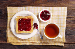 Tea and toast with jam Stock Photo
