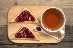 Tea and toasted bread with jam Stock Photos