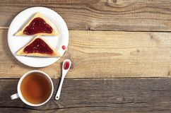 Tea and toasted bread with jam Royalty Free Stock Photography