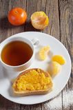 Tea and toasted bread with tangerine jam stock photography
