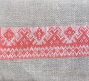 Tea towel with a folk design. Tea towel with a red Embroidery folk design Stock Photo