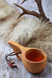 Tea in traditional finnish cup kuksa Royalty Free Stock Photography