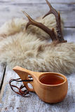 Tea in traditional finnish cup kuksa Stock Photography
