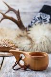 Tea in traditional finnish cup kuksa Stock Photos