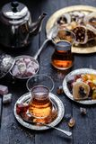 Tea in traditional turkish glasses with oriental delights and sweets.  Royalty Free Stock Photos