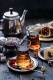 Tea in traditional turkish glasses with oriental delights and sweets.  Stock Photos