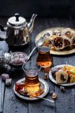 Tea in traditional turkish glasses with oriental delights and sweets.  Stock Images