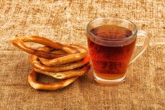 Tea in a transparent cup and bagels Stock Photography