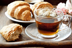 Tea in Transparent Cup with Croissants Royalty Free Stock Photo