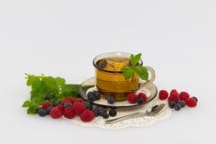 Tea in a transparent cup Stock Photos