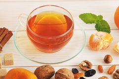 Tea with transparent glass mug with nuts Stock Photo