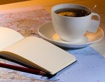Tea and travel plan Stock Photography