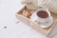 Tea tray and sweater. White wood background, toned Royalty Free Stock Photography