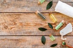 Tea tree spa composition. Fresh tea tree leaves, natural cosmetics, towel on rustic wooden background top view copy. Tea tree spa composition. Fresh tea tree royalty free stock photography