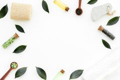 Tea tree spa composition. Fresh tea tree leaves, natural cosmetics, towel on white background top view space for text royalty free stock photography