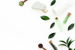 Tea tree spa composition. Fresh tea tree leaves, natural cosmetics, towel on white background top view space for text. Tea tree spa composition. Fresh tea tree stock photos