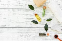 Tea tree spa composition. Fresh tea tree leaves, natural cosmetics, towel on white wooden background top view space for. Tea tree spa composition. Fresh tea tree stock image
