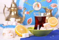 Tea with Turkish Delight and lemon Royalty Free Stock Images