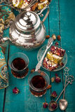 Tea and turkish delight on wooden background stock photos