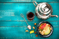 Tea and turkish delight on wooden background royalty free stock photo