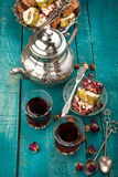 Tea and turkish delight on wooden background stock photo