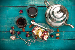 Tea and turkish delight on wooden background stock photography