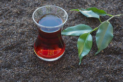 Tea in the Turkish glass beaker. Is dry black tea Stock Photography