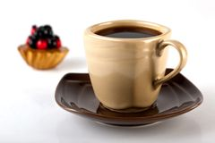Tea and turty. A cup of tea and cake on white Royalty Free Stock Images