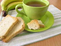 Tea and twice baked crisp bread and banana Royalty Free Stock Image