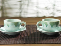Tea for two. On the bamboo place mat royalty free stock photography