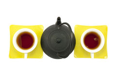 Tea for two, female-female organised. Teapot with two cups, filled with tea, female-female organised Royalty Free Stock Photography