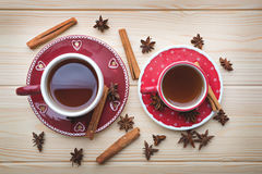 Tea for two. Tea fot two, hot tea in red cups on wooden table stock photo