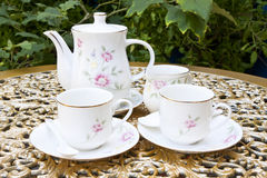 Tea for Two in the Garden on Golden Decoration Table Stock Photos