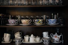 Tea utensils, coffee and beverages on the shelves Royalty Free Stock Images