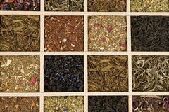 Tea variation. Various dry tea leaves - green, black, rooibos in wooden box Royalty Free Stock Photos