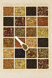 Tea variation. Different tea sorts in wooden box. Dry tea leaf collection. Top view Stock Image